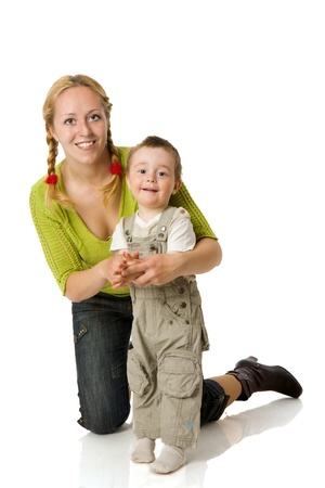 Happy mother holding two years son isolated on white Stock Photo - 9239522
