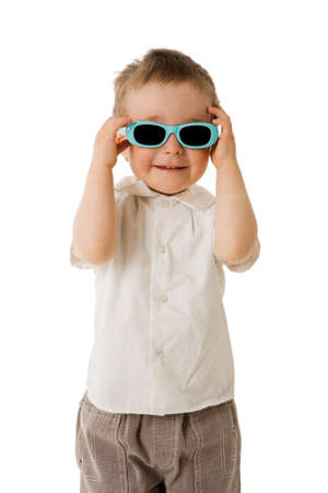 Two years boy wearing sunglasses isolated on white photo