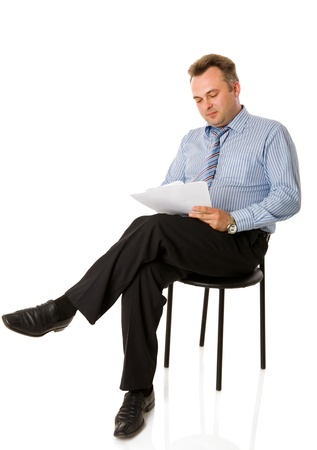 1 man only: Portrait of Businessman reading papers isolated on white