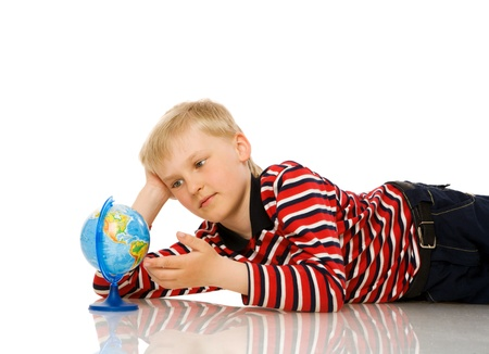 seven years: seven years boy with globe isolated on white