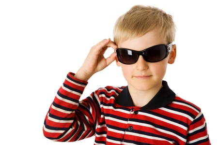 Happy seven years boy wearing sunglasses isolated photo