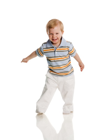 1 2 years: Two years boy standing on floor isolated on white