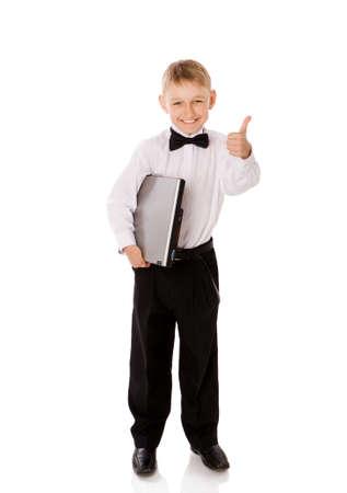 schooler: Six years Boy holding laptop isolated on white Stock Photo