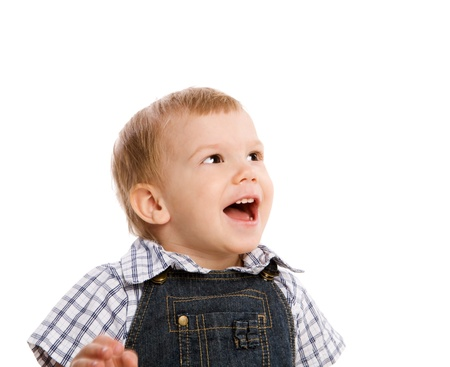 One year boy smiling looking up isolated on white photo