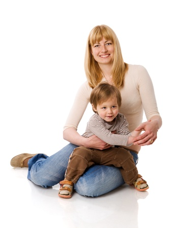 Happy mother holding two years son isolated on white