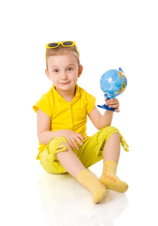 Three years girl with globe isolated on white photo