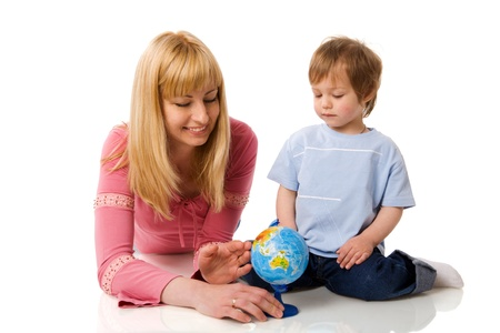 Happy mother holding globe with son isolated on white photo