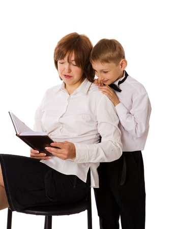 Mother reading book to her son isolated on white Stock Photo - 9442619