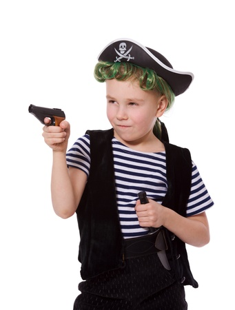 Boy wearing pirate costume shooting pistol isolated on white photo