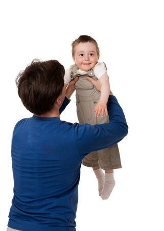 Happy father holding one years son back view isolated photo
