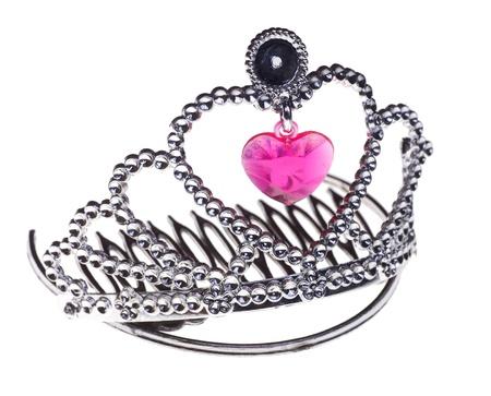 Fake silver princess diadem toy isolated on white photo