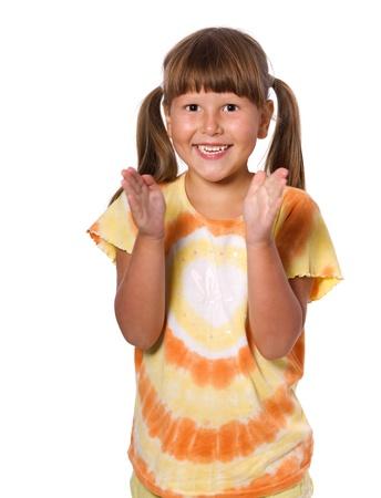 manos aplaudiendo: Feliz clapping retrato ni�a de seis a�os aislado Foto de archivo