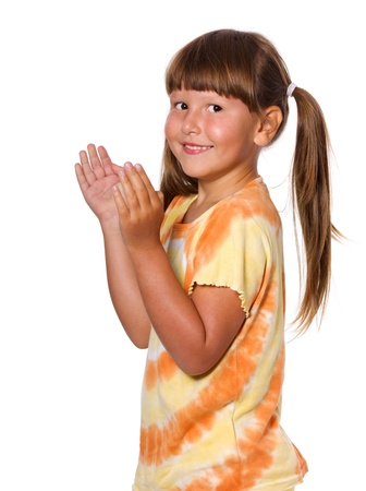 Happy clapping six years girl portrait isolated Stock Photo