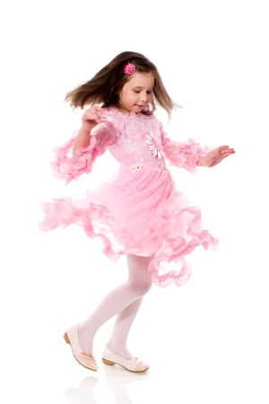 pirouette: Cheerful girl dancing jumping isolated on white Stock Photo