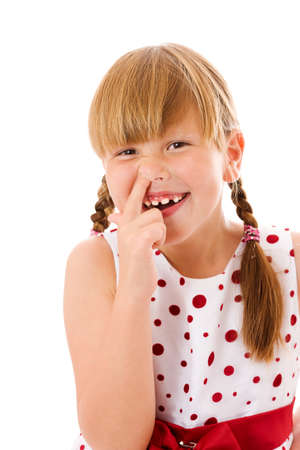 nose picking: Seven years girl picking her nose isolated on white