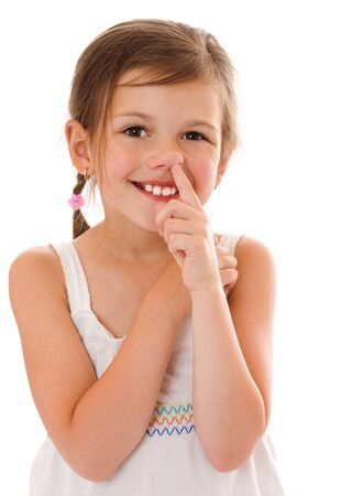 goofing: Seven years girl picking her nose isolated on white