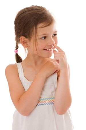 picking fingers: Seven years girl picking her nose isolated on white