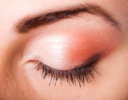 Macro shot of closed female eye with clorful make up Stock Photo