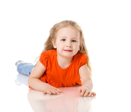 Cheerful two years girl staring up dreaming isolated on white photo