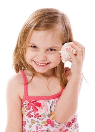 4 of a kind: cheerful Little Girl listening shell isolated on white