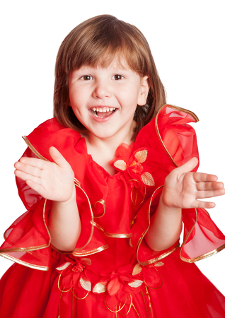 flowergirl: laughing girl clapping hands wearing holiday red dress isolated