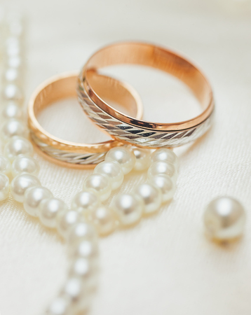 purls: Two Golden Wedding Rings with purls macro shot Stock Photo