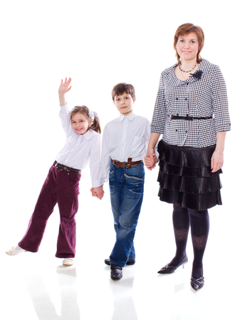 full lenght: Mother with two children standing full lenght isolated on white