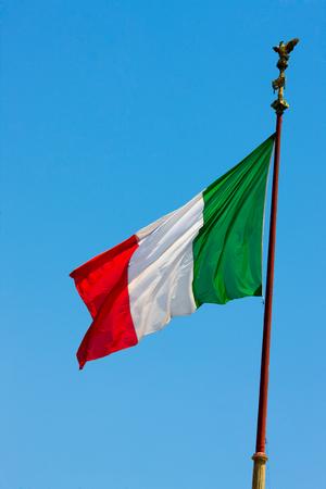 raise the white flag: National flag of Italy over clear blue sky