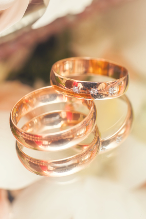 diamond rings: Two Golden Wedding Rings with diamond macro shot Stock Photo