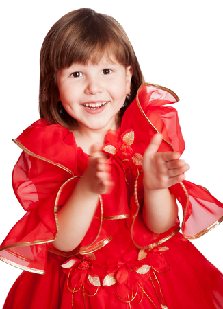 flowergirl: girl clapping hands wearing holiday red dress isolated hand blurred of movement Stock Photo
