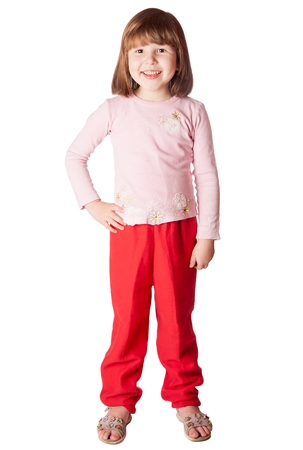 red hair girl: Little Girl wearing pink sweater and red pants standing isolated