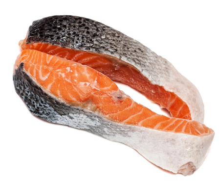 and the stakes: Two stakes from raw salmon fish isolated on white background Stock Photo