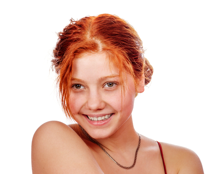 Portrait of happy cheerful young redhead woman isolated on white photo