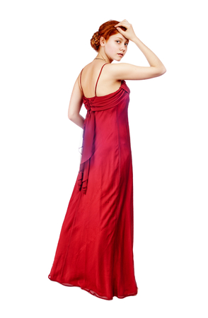 young woman wear red dress standing isolated on white photo