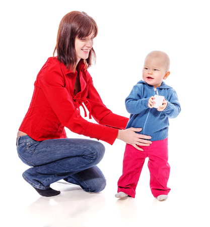 Toddler sharing toy with mother isolated on white photo