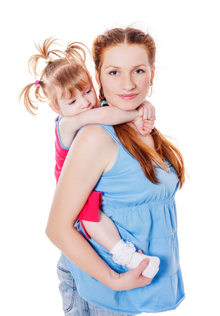 two years: Mother holding two years daughter isolated on white Stock Photo