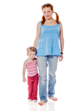 two years: Mother standing with two years daughter isolated on white