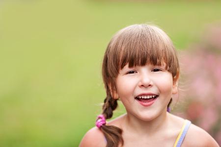 Happy five years Girl smiling outdoors headshot