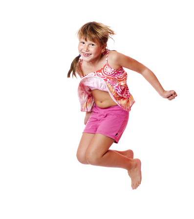 Happy excited Jumping girl isolated on white photo