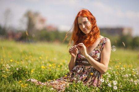 Young woman relax happy in summer meadow photo