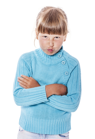 capricious: Upset cranky girl standing crossed hands isolated on white background Stock Photo