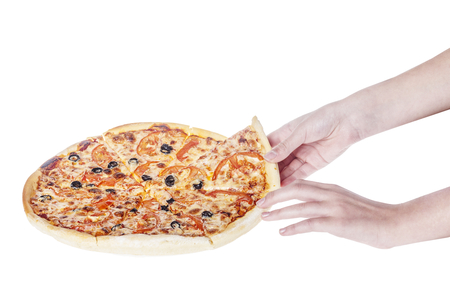 Hand holding a slice of delicious pizza isolated on white