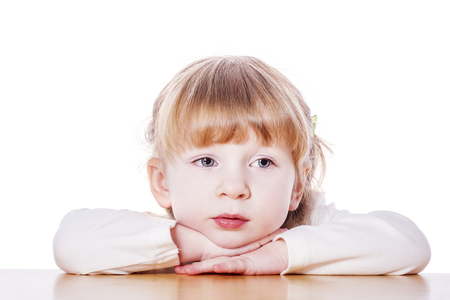 Close-up portrait of Pensive child isolated on white