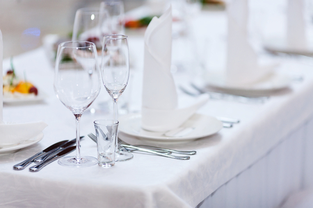 Glasses and plates on Restaurant Table before big Party begins