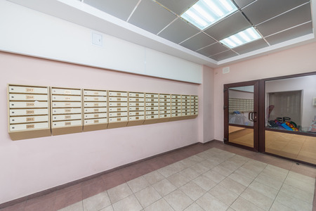 Empty hall mailboxes and doors at new apartment building 版權商用圖片