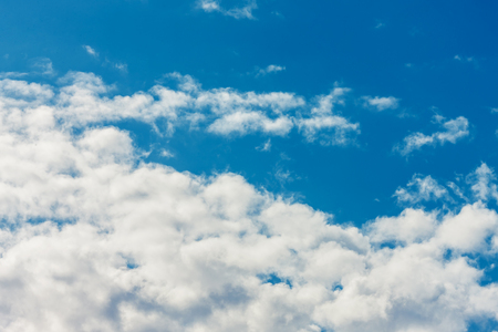 Deep blue bright sky with clouds