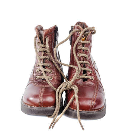 Brown leather boots with zipper and shoe-laces isolated on white