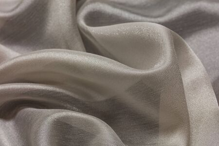 Shiny cloth background with white vial textile multiple curls Standard-Bild