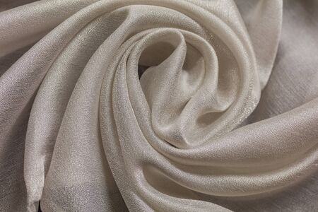 Shiny cloth background with white vial textile multiple curls