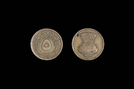 Egypt coin 5 piastres 1972 with inscription meaning 5 PIASTRES Arab Republic of Egypt. Black background.